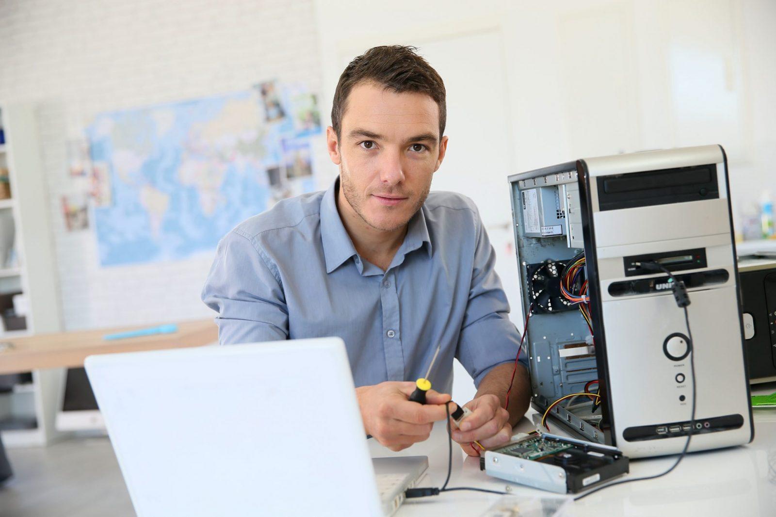 Man Sat with Desktop PC